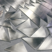 Sanded steel parts
